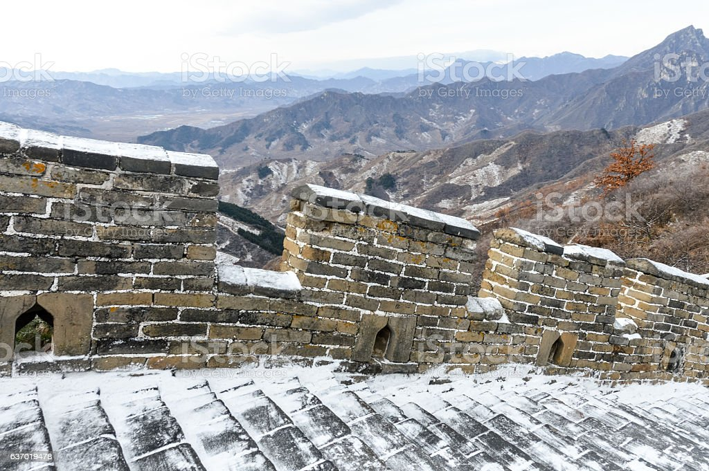 The Great Wall of China covered in light snow stock photo