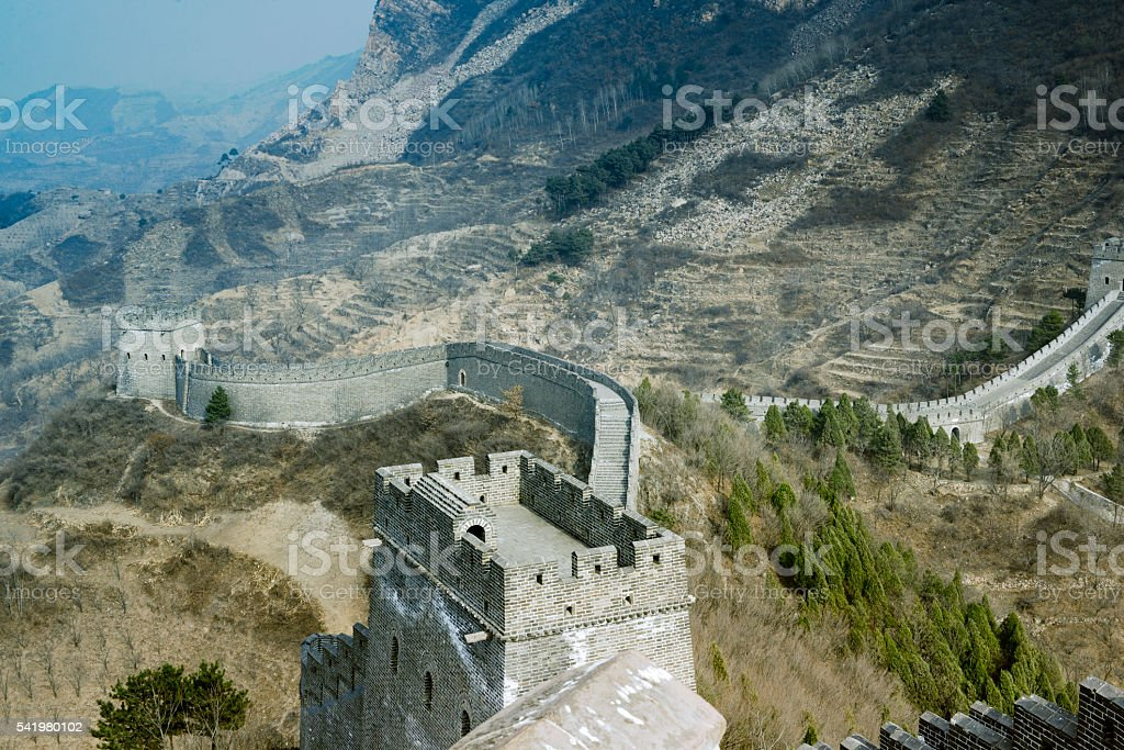 The Great Wall of China over mountains in Beijing, China. stock photo