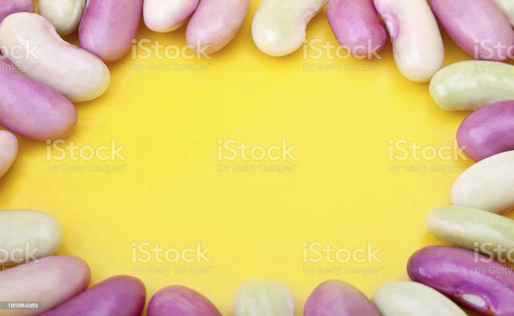 The green beans framed on yellow background stock photo