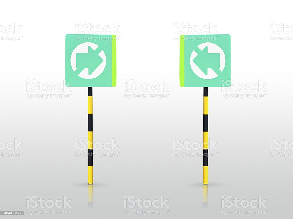 the green directional sign not in reflection on  floor royalty-free stock photo
