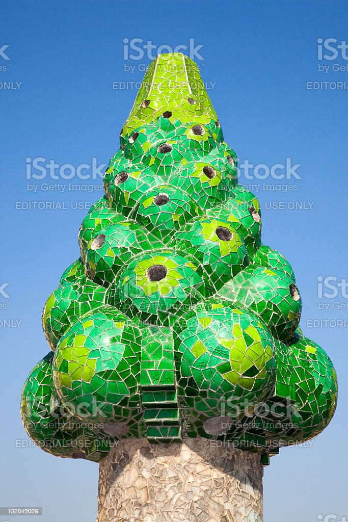 The green mosaic chimney  restored by Antoni Gaudí royalty-free stock photo