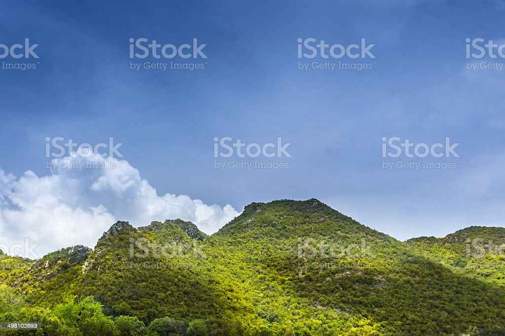 The green mountain and blue sky stock photo