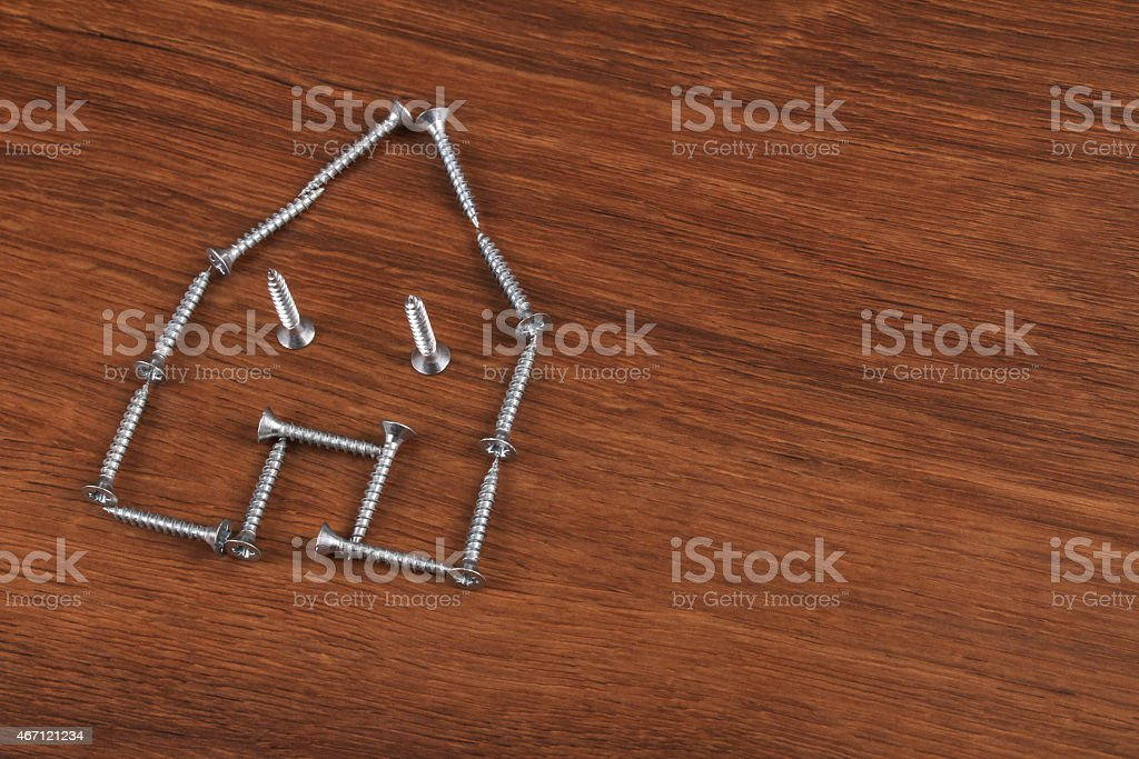 The Grey Screw on the wood stock photo