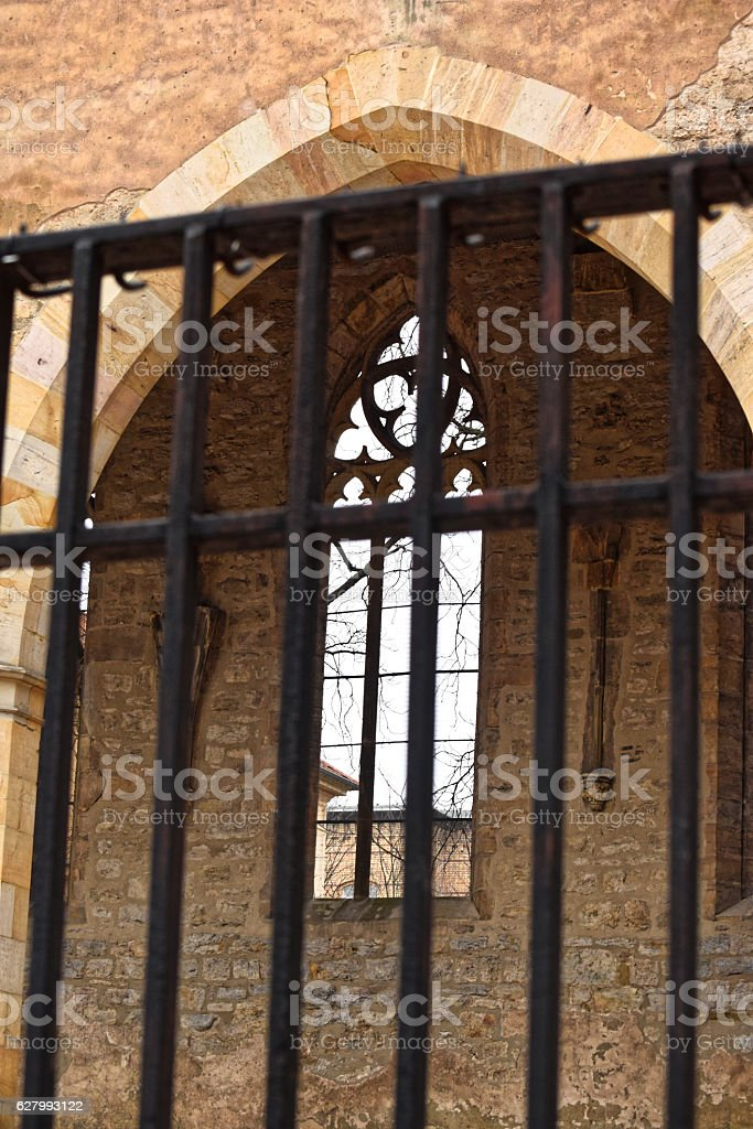 The grid near the gate of the old Church. stock photo