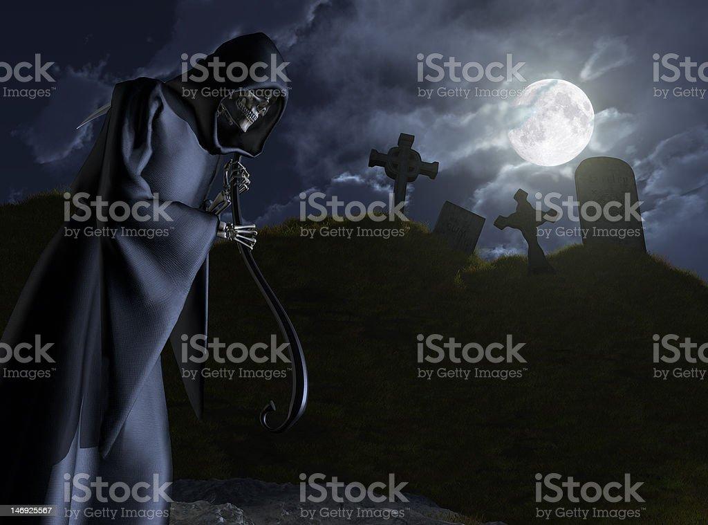 The Grim Reaper Stalks a Cemetery stock photo