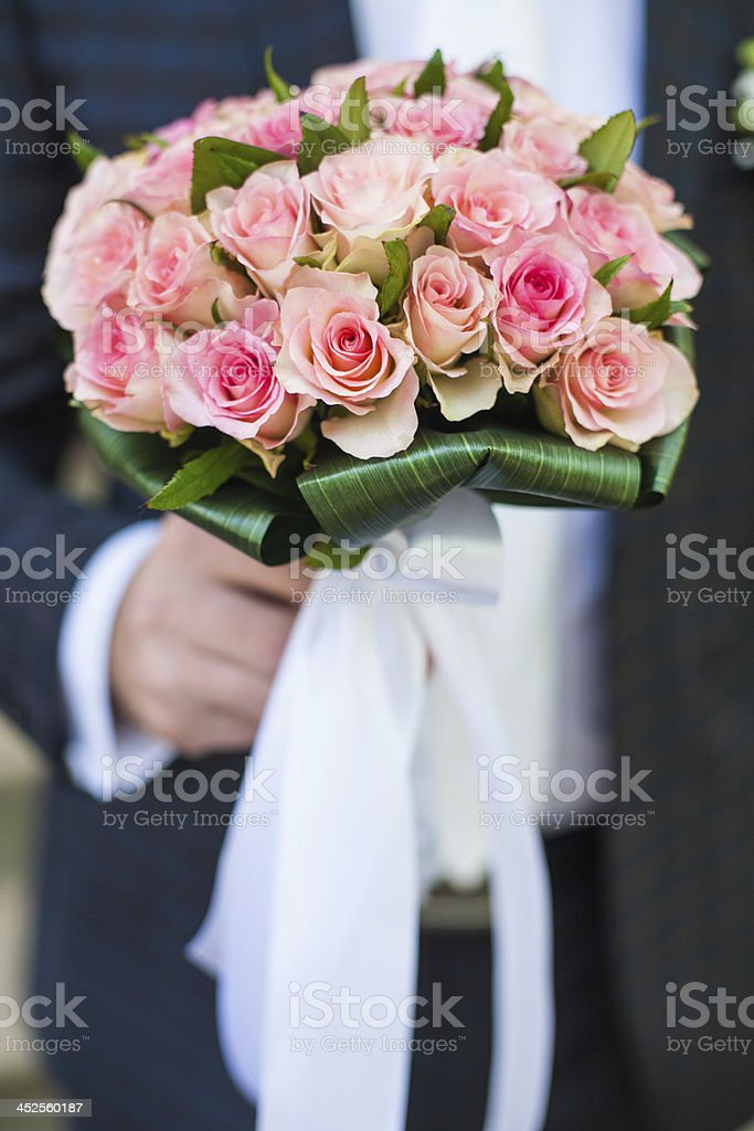 The groom is holding a bouquet royalty-free stock photo