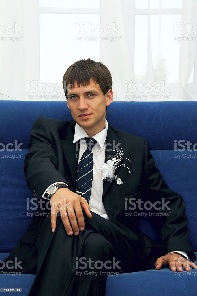 The groom sitting on a sofa royalty-free stock photo