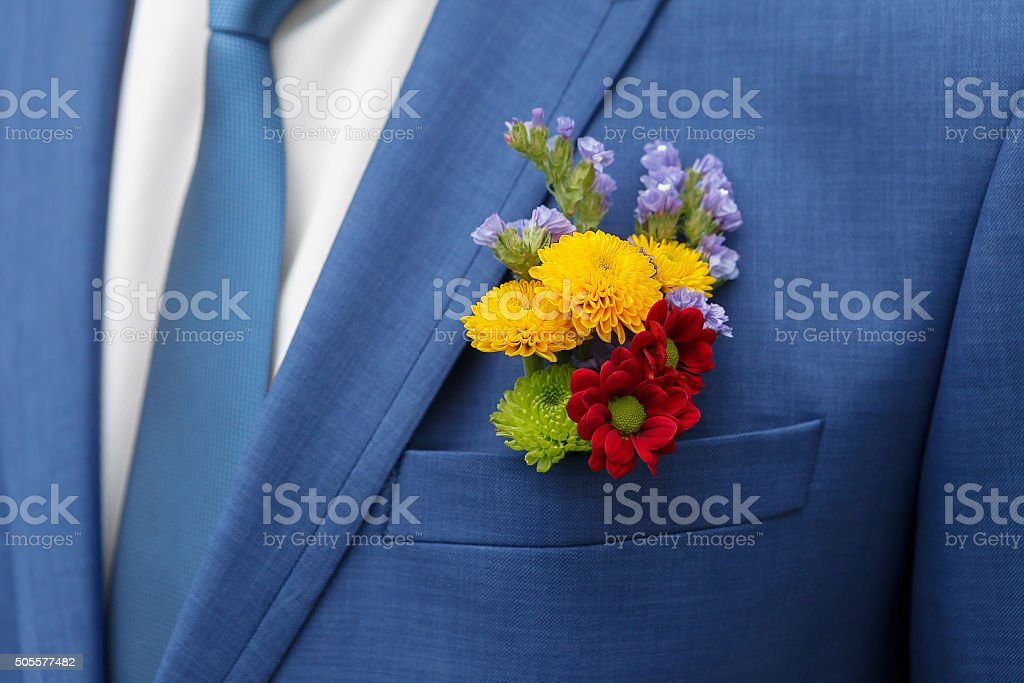 the groom's beautiful  boutonniere stock photo