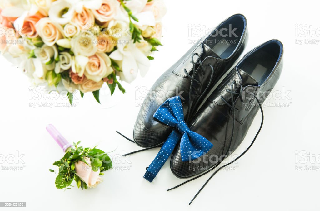 The groom's shoes with a blue butterfly, a buttonhole stock photo