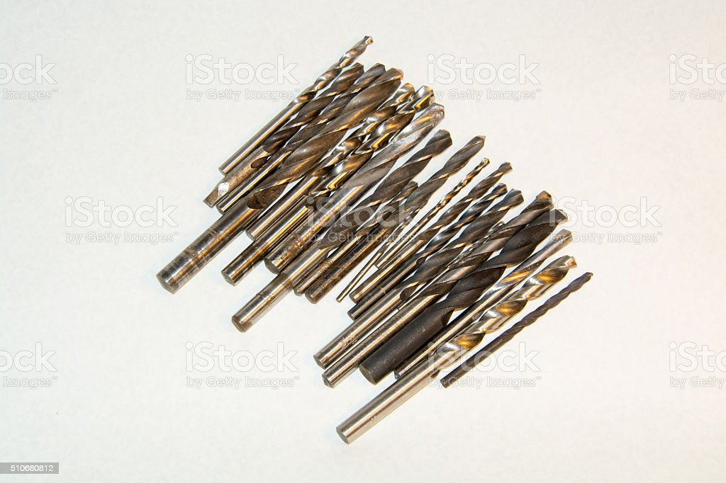 The group of drill bits different diameters on white background stock photo
