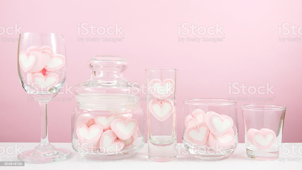 The group of lovely pink heart marshmallows in variety glass stock photo