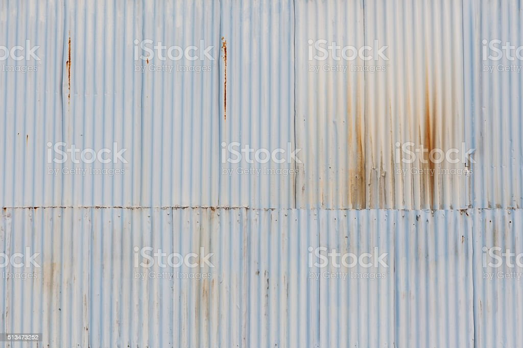 The grunged corrugated grey metal wall background. stock photo