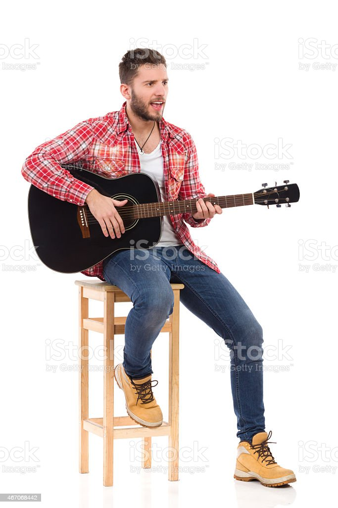 The guitarist on a chair stock photo