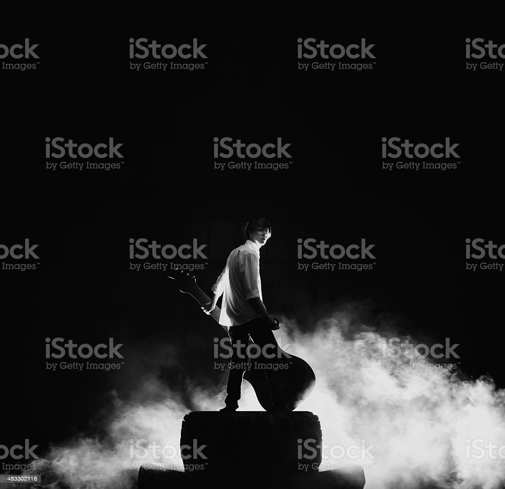 The guitarist playing on large electric guitar in a great stock photo