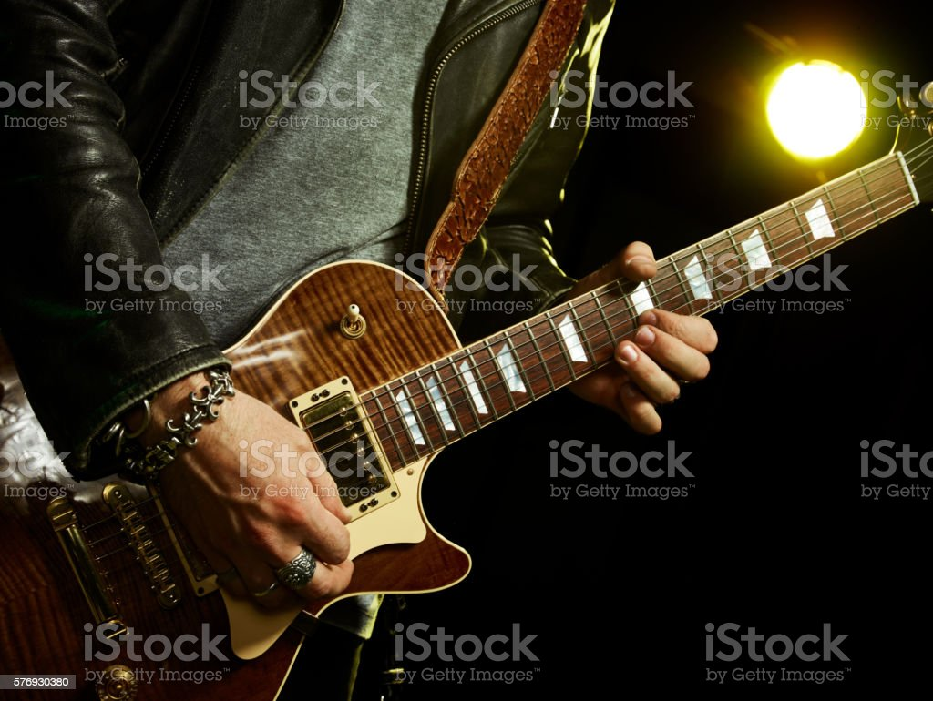 The guitarist plays solo. stock photo
