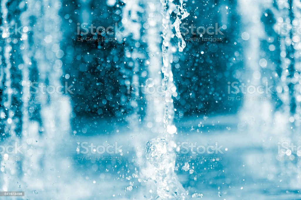 The gush of water in a fountain stock photo