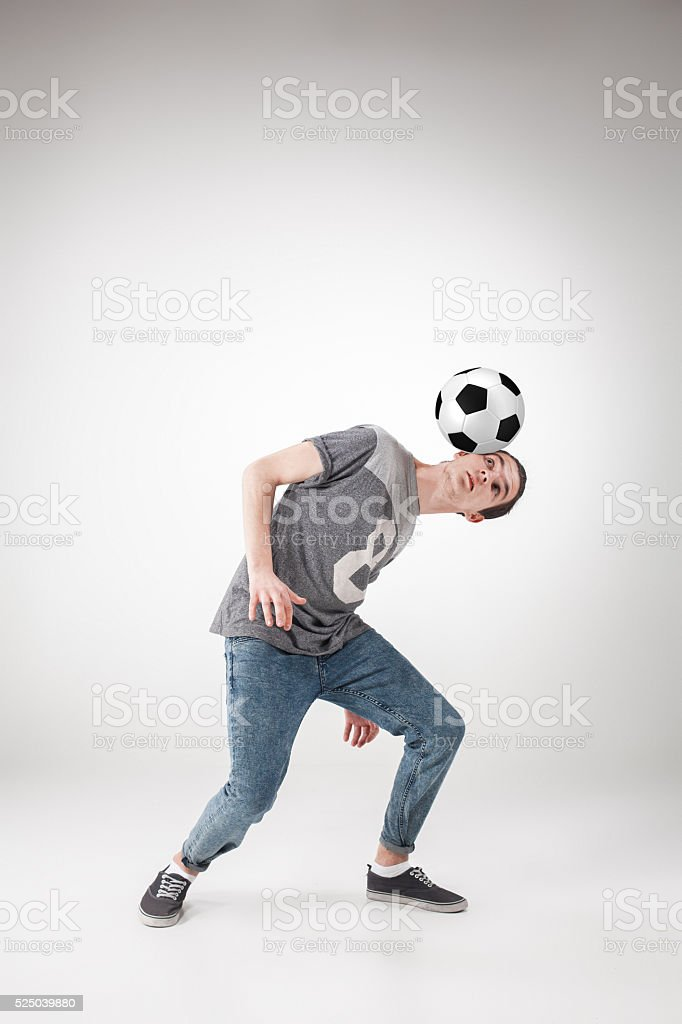 The guy with ball on gray background stock photo