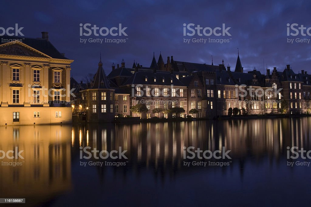 The Hague's illuminated parliament buildings and Mauritshuis museum royalty-free stock photo
