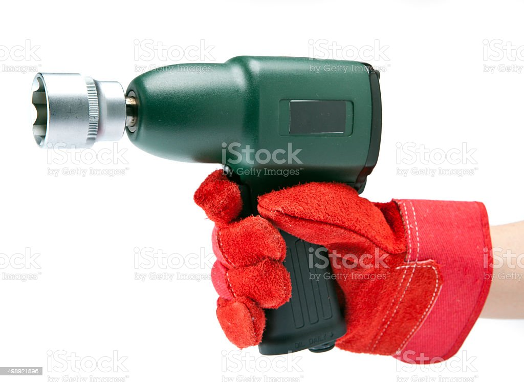 the hand holds air impact wrench stock photo