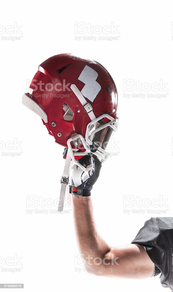 The hand of american football player with helmet on white stock photo