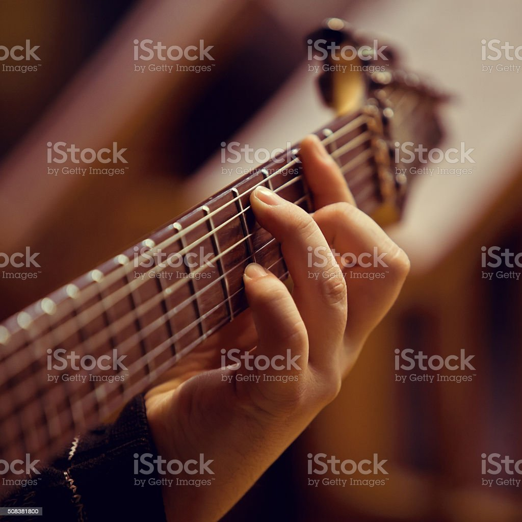 The hand of man playing guitar stock photo