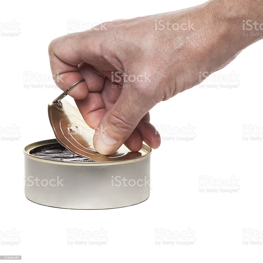 The hand opens a can stock photo