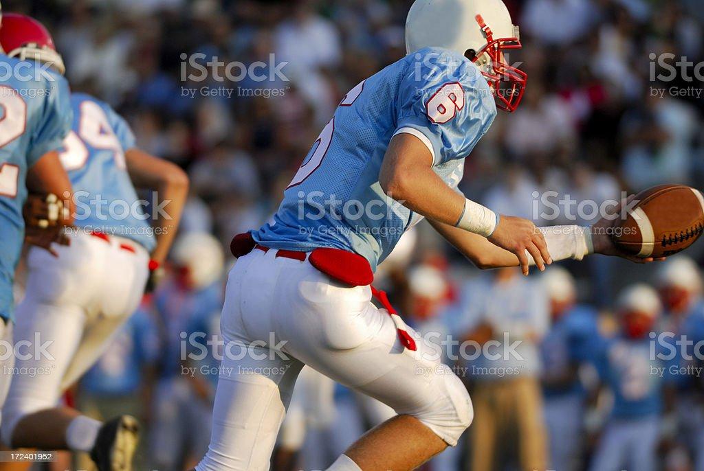 The handoff, american football royalty-free stock photo
