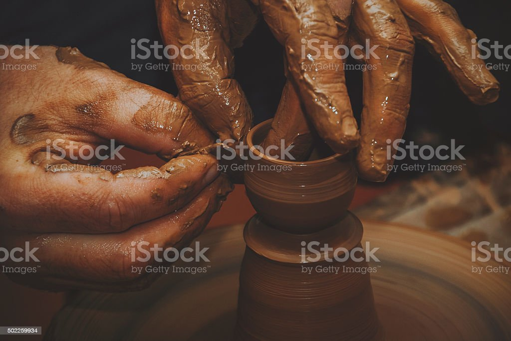 The hands of a potter stock photo