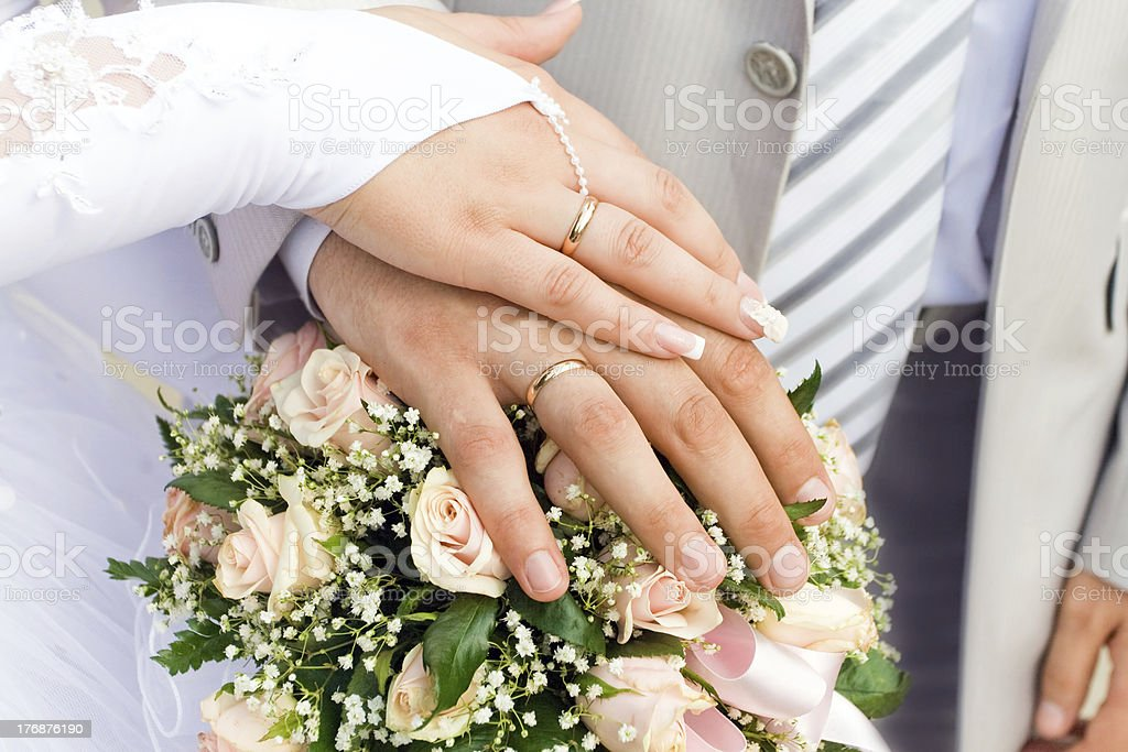 The hands of just married couple royalty-free stock photo