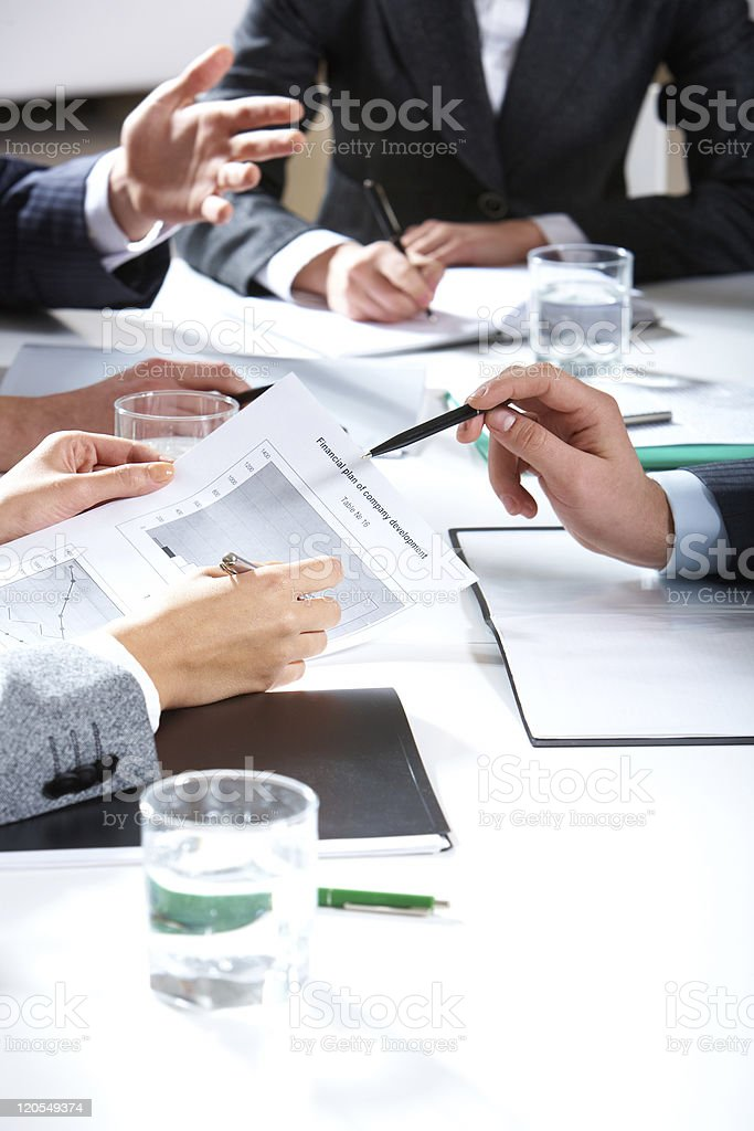 The hands of several people at an office meeting royalty-free stock photo
