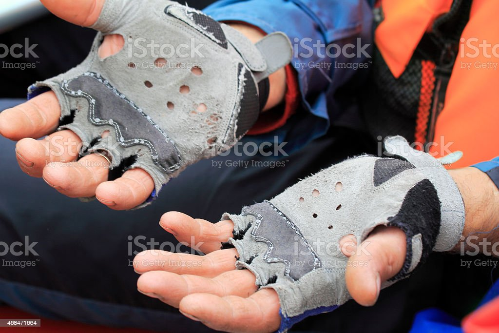 The hands of travelers in worn leather gloves stock photo