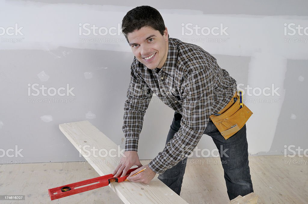 The  Handyman drawing a line royalty-free stock photo