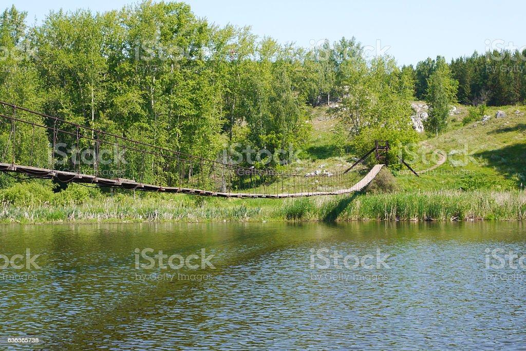 the hanging bridge across the river stock photo