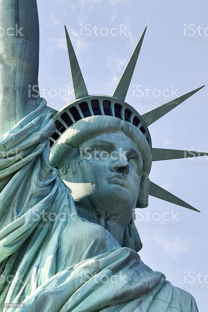 The head and upper chest of the Statue of Liberty from below stock photo