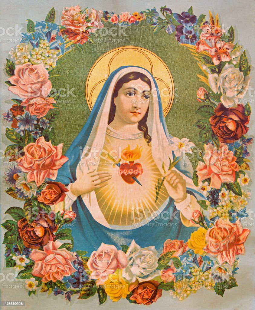 The Heart of Virgin Mary in the flowers. stock photo