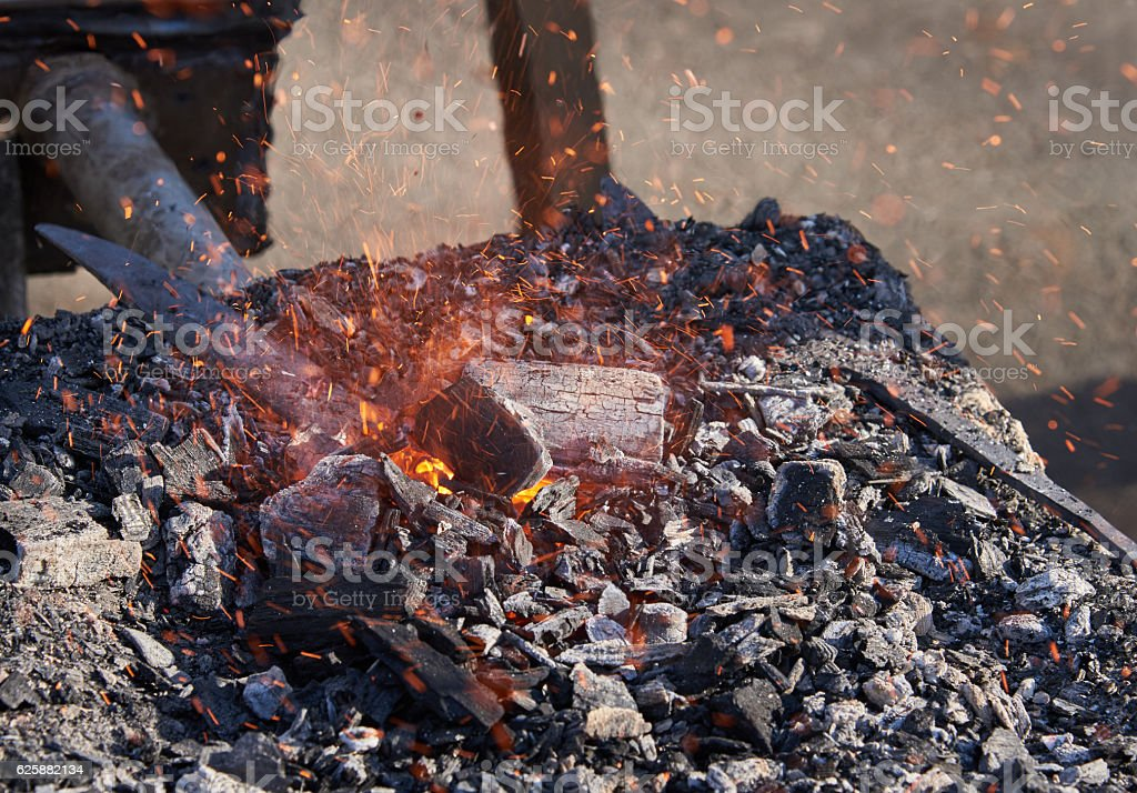 The heating of metal billets on hot coals royalty-free stock photo