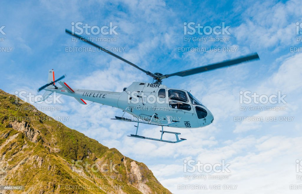 The helicopter carries the visitor through Fox glaciers Southern island, New Zealand stock photo