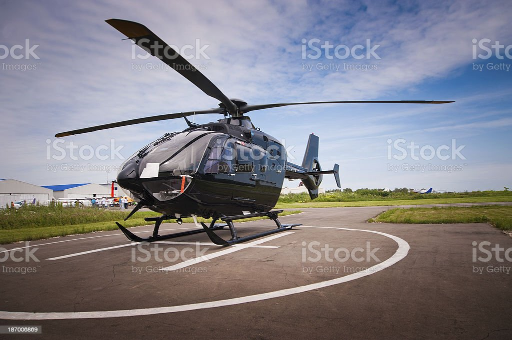 The helicopter in airfield stock photo
