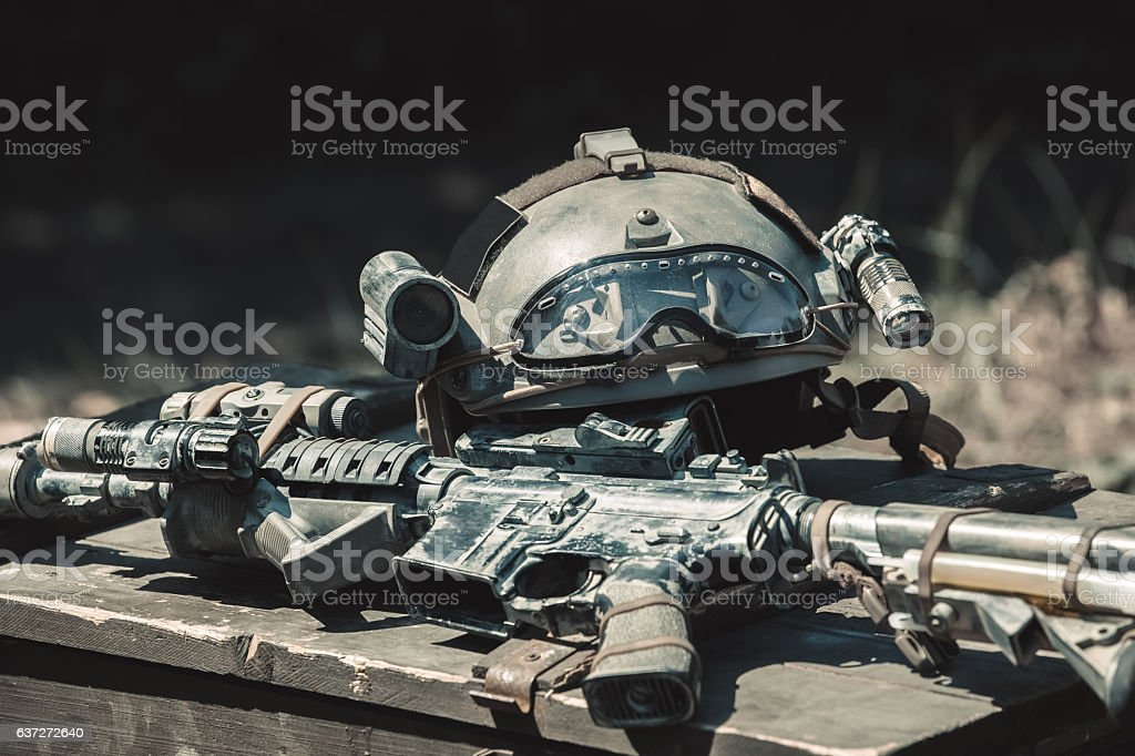 The helmet and the machine are on the box. stock photo