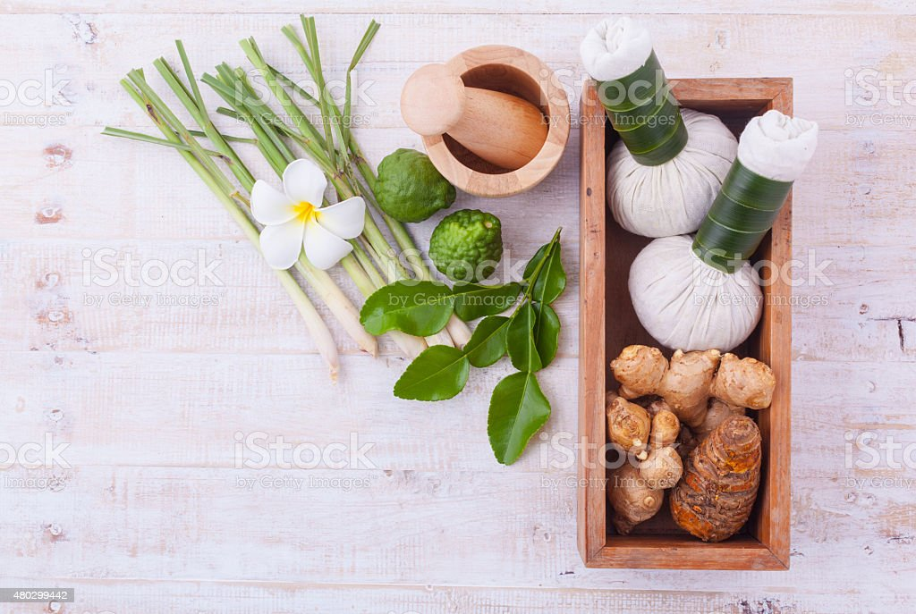 The herbal compress ball and massage oil for spa treatment. stock photo