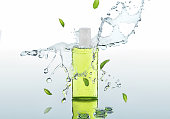The herbal  moisturizing shampoo stands on the water background