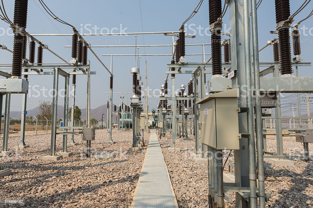 The high voltage equipment in the outdoor electrical substation stock photo