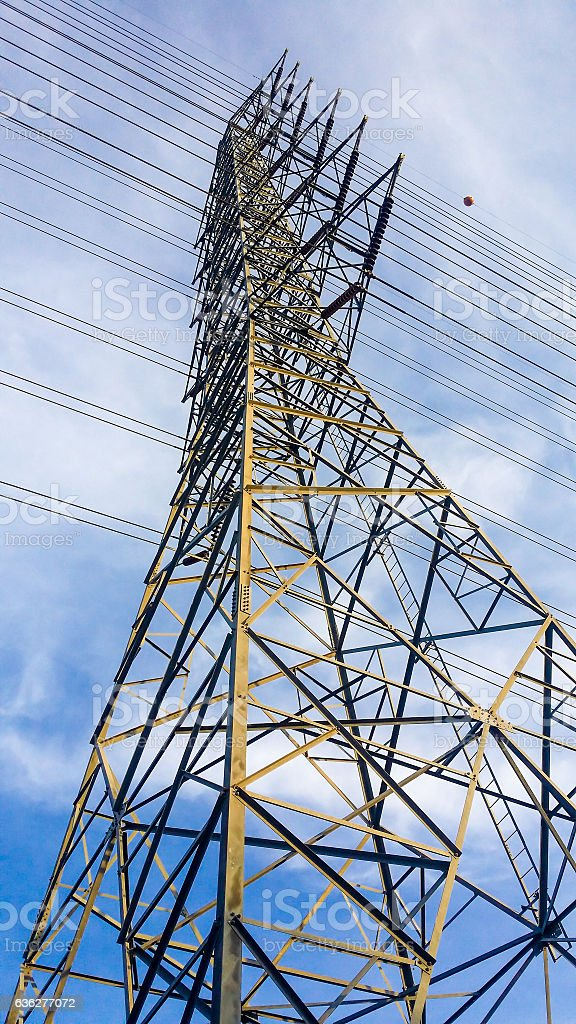 the high voltage post. High-voltage tower sky background stock photo