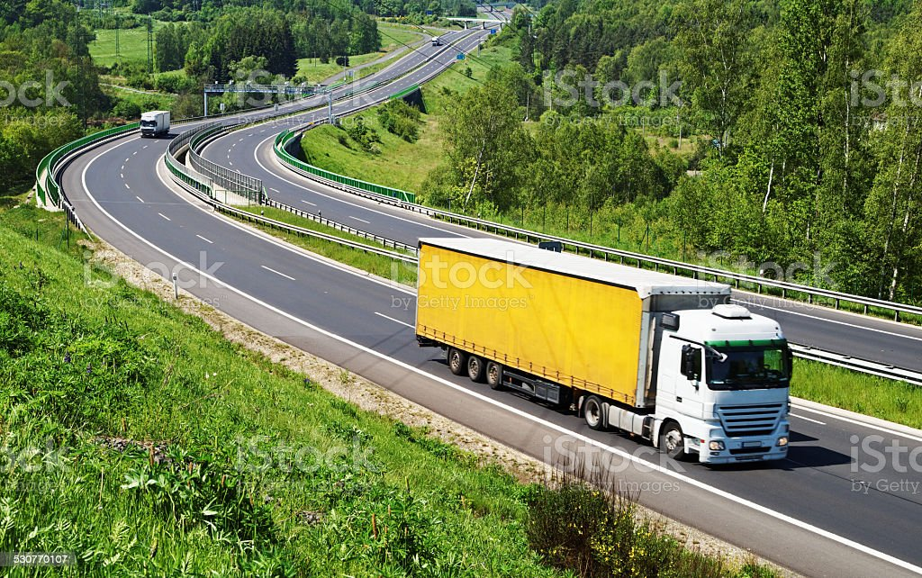 The highway between woods, electronic toll gates stock photo