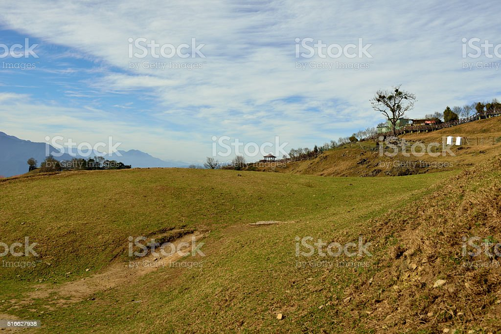 The hill commands a fine distant view . stock photo