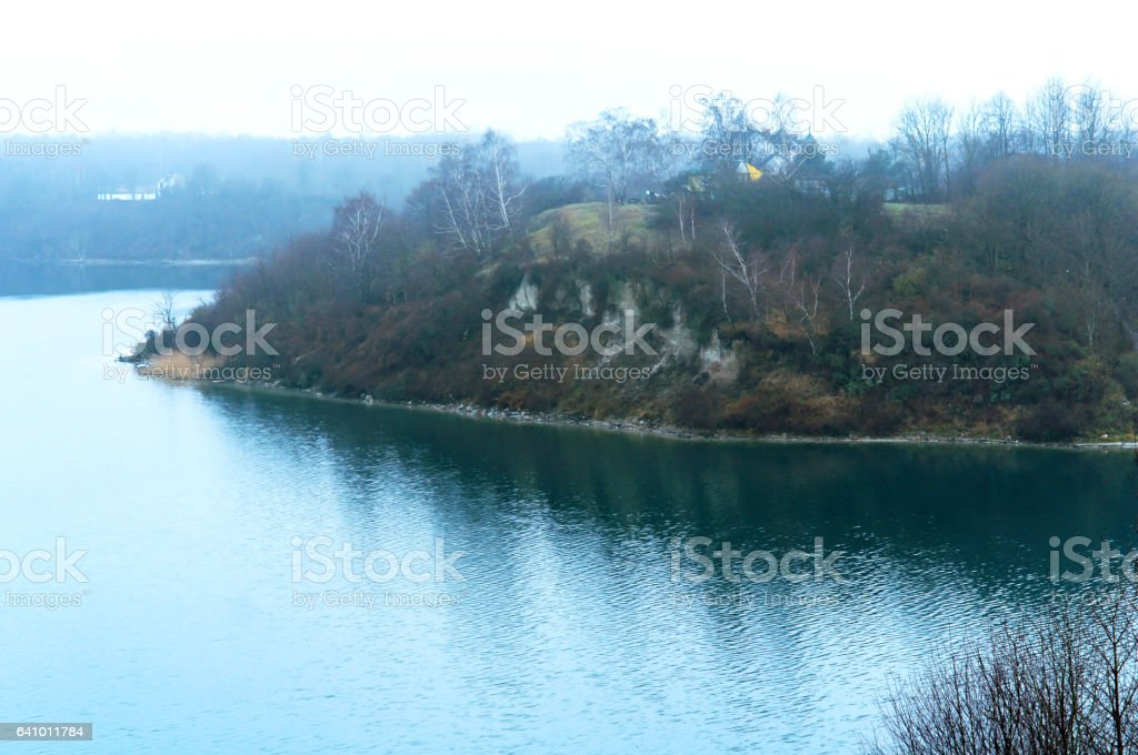 the hill over the lake, overcast, lonely, fall stock photo