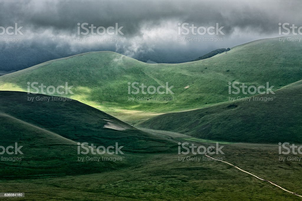 The hills of Castelluccio during a thunderstorm stock photo