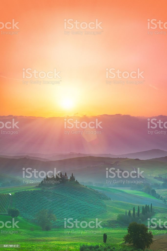 The hills of Val d'Orcia in Tuscany, Italy at sunrise. stock photo