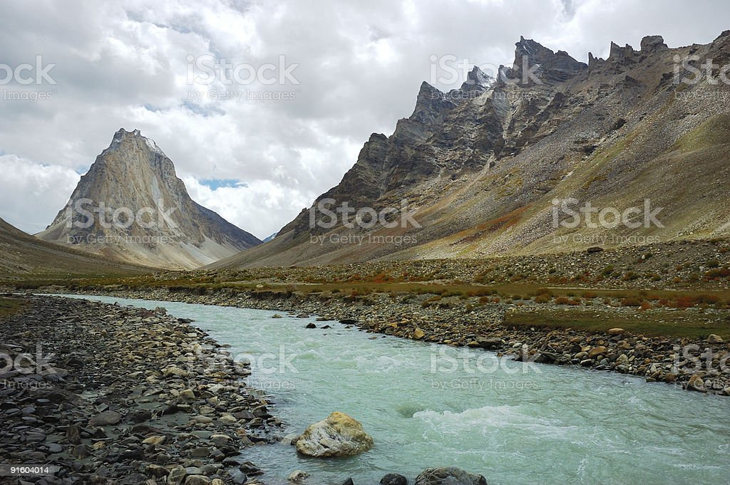The Himalayan river surrounded by large mountain ranges stock photo