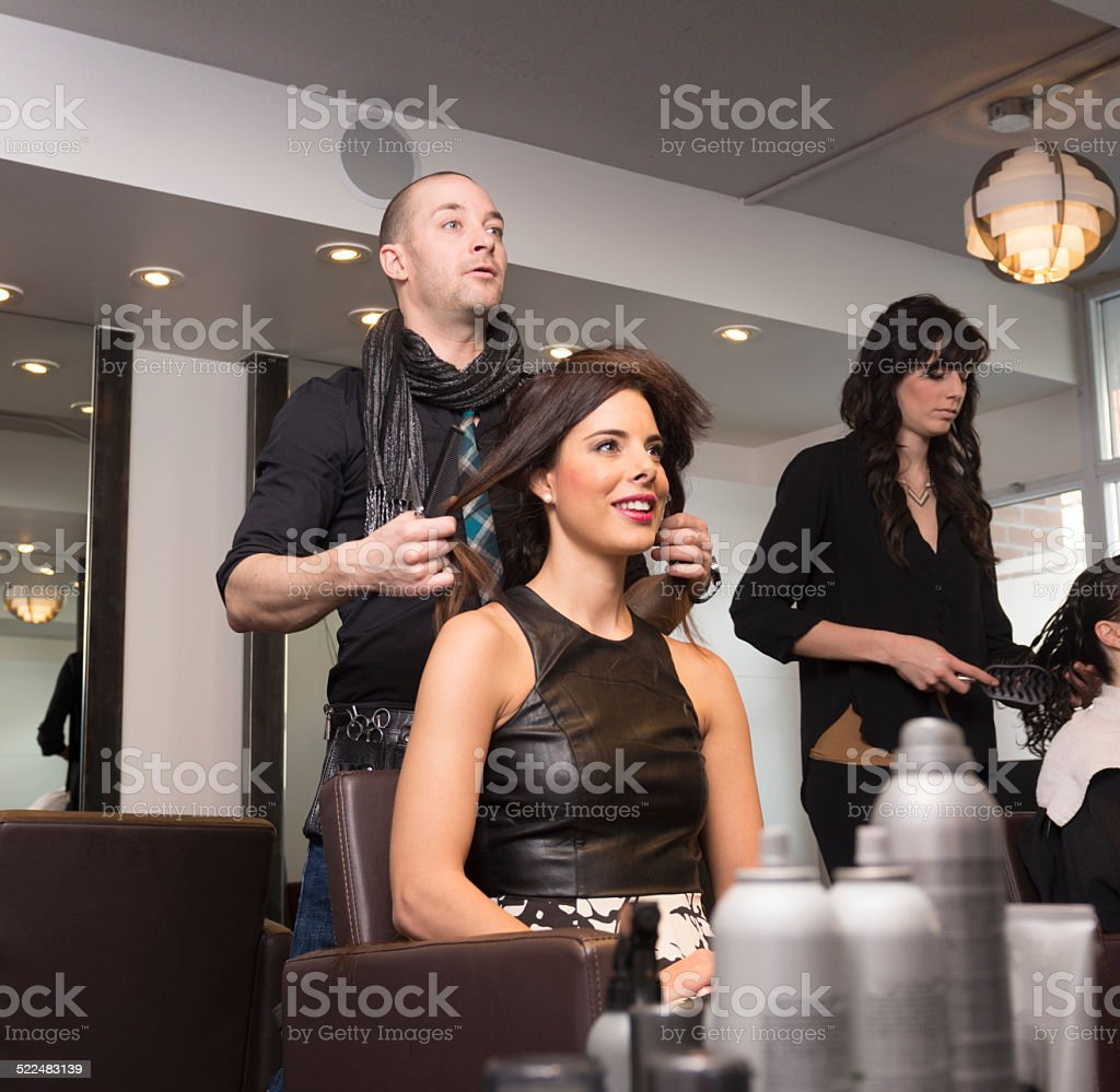 The Hipster Hair Stylist and the Model stock photo